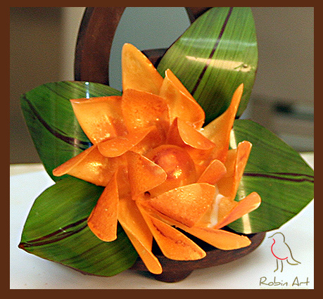 Chocolate flower and leaves embellished with colored cocoa butter